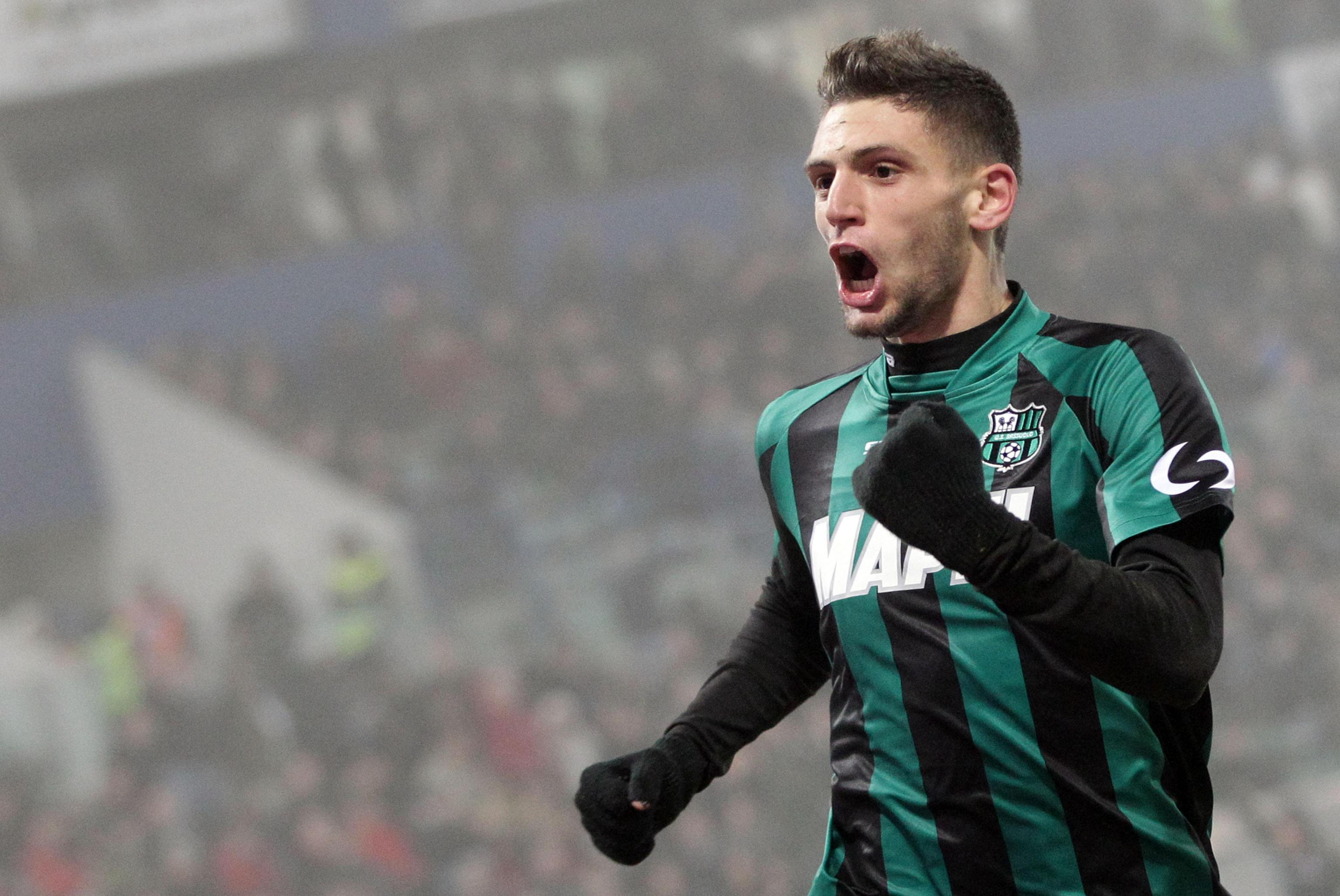 Italian forward Domenico Berardi of Sassuolo celebrates after scoring the 3-2 goal against Ac Milan during Italian Serie A soccer match Sassuolo-Milan at Mapei Stadium in Reggio Emilia, 12 January 2014. ANSA/ELISABETTA BARACCHI